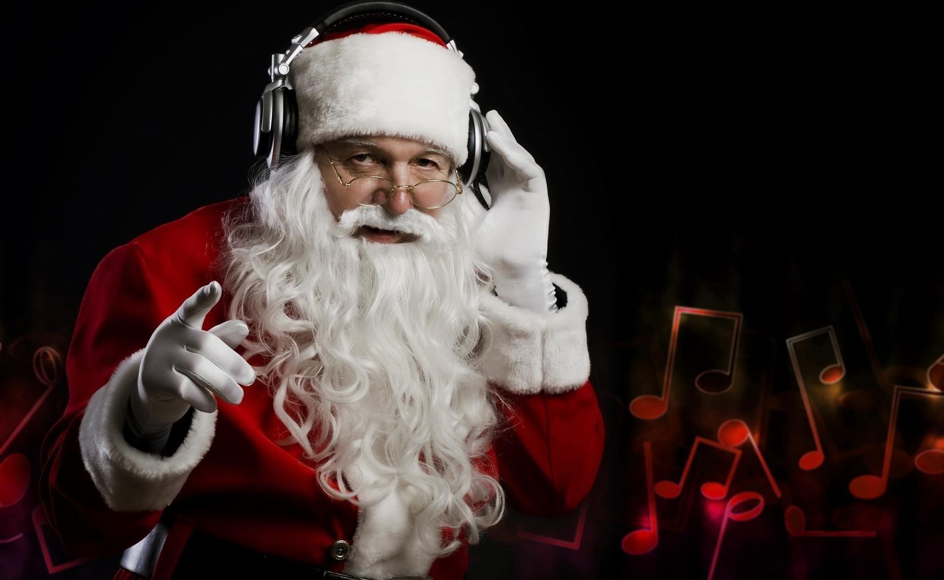 Santa Claus wearing headphones